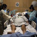 U.S. Surpasses 3,600 Daily Coronavirus Deaths, Breaks Prior Hospitalization Record